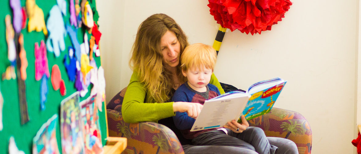 Mom and son reading. Photo credit: Erik Bergen, Placer County